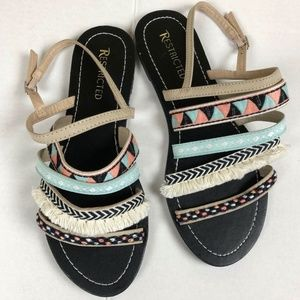 Restricted fringed sandal